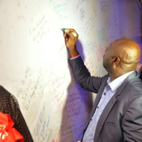 Segun Arinze Signing The Wall.jpeg