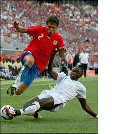 Sulley Muntari impresses in midfield for the World Cup debutants, going close on goal twice in the opening stages
