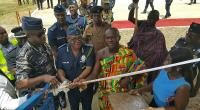 The IGP, John Kudalor cutting tape to open the Police Hostel