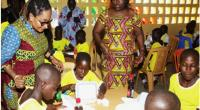 Mrs Lordina Mahama and Nana Oye Lithur, the Minister of Women, Gender and Social Protection, interacting with the children in the dining hall
