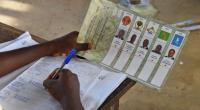 A member of Togo's electoral commission counts ballots for the presidential election vote at a polling station on April 25, 2015 in Lome.  By Issouf Sanogo (AFP/File)