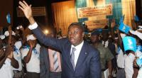 Togo's President Faure Gnassingbe waves to supporters during the Union for the Republic's national gathering in Kara on February 25, 2015.  By Emile Kouton (AFP/File)