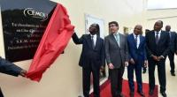 President of the Ivory Coast Alassane Ouattara (C), CEO of French chocolate manufacturers Cémoi Patrick Poirrier (2-L) unveil a plaque during the innauguration of a CEMOI factory in Abidjan on May 18, 2015.  By Issouf Sanogo (AFP)