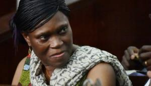 Former Ivorian first lady Simone Gbagbo looks on at Abidjan's courthouse on October 10, 2016 before the re-opening of her trial, which her lawyers said October 24, 2016 they would refuse to participate in