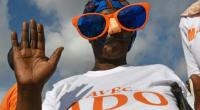 A supporters of Ivory Coast President Alassan Ouattara attends a campaign rally on October 23, 2015 in Abidjan.  By Sia Kambou (AFP)
