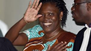 Former first lady Simone Gbagbo waves as she arrives at the Court of Justice in Abidjan, Ivory Coast on February 23, 2015.  By Issouf Sanogo (AFP/File)
