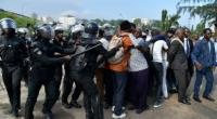 Ivory Coast's police officers arrest a members of the Ivory Coat's oppostion, among them Aboudramane Sangare (5R), one of country's opposition leaders, during a protest against a referendum on the adoption of a new constitution.  By Issouf Sanogo (AFP)