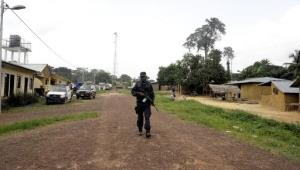 A Rapid Response Unit police officer patrols near Toe Town, Liberia, close to the border with Ivory Coast, on May 20, 2015.  By Zoom Dosso (AFP)