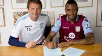 New signing Jordan Ayew of Aston Villa poses for a picture with Aston Villa manager Tim Sherwood
