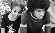Lovely childhood: Michael and sister Janet