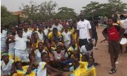 """Tema Community 2 No 4 Primary School Pupils With A """"Denkyem"""" Official."""