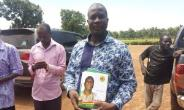 MP for Tatale Sunguli constituency donates exercise books to his constituency