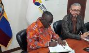 Mr Kwadwo Owusu Afriyie signing the agreement on behalf of Ghana
