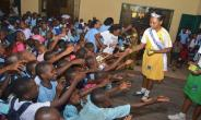 8 year old Beauty Queen Zikora (Little  Miss Health )donates Educational Materials, Sues for healthy environment