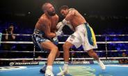 Oleksandr Usyk sends Tony Bellew reeling on the way to his victory over the Liverpudlian at the Manchester Arena. Photograph: Nick Potts/PA