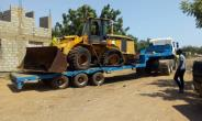 The missing payloader being towed away