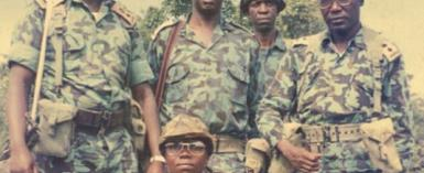 Besigye (L) and his comrades during the bush war