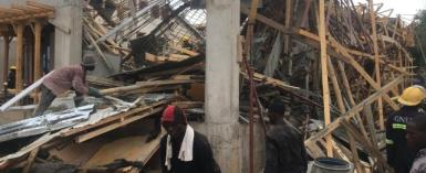 Building under construction caves in; one feared trapped in rubble