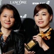 An actresses displaying their awards