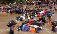 A group of migrants cross the river Suchiate connecting Guatemala and Mexico: The refugee caravan is still thousands of miles from the US border