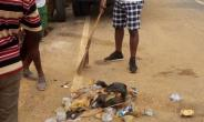 Jomoro MP, Hon. Paul Essien in action cleaning the streets