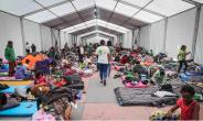 A group of migrants in an emergency shelter in Mexico City: Already 3230 refugees from Central America have applied for asylum in Mexico.