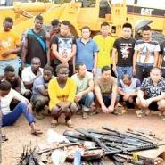 The alleged galamseyers and weapons retrieved from them