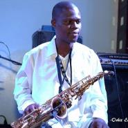 Singer, K1 Grief-Striken as Saxophonist Dies