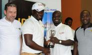 One Of The Winners Receiving His Prize From Awuah (In Cap)