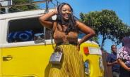 Actress, Jackie Appiah Steps out in Matching Out with Commercial Bus