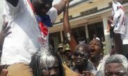 Vincent Sowah Odotei enjoys a shoulder ride