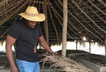 Actor, John Dumelo shows of his Snail Farm