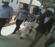 Hon. Lawyer Charity Akua Foriwaa Dwommor , middle  taken round the hospital by engineers on site during the tour.
