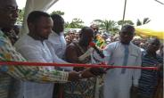 Board Chairman of the AngloGold Ashanti Community Trust Fund, Professor Newton Amegbey supported by MD of the Mine and MP for Tarkwa Nsuaem to cut tape for the health center