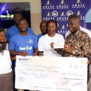 Distributors of Awake Water presenting the cheque to Dr Lawrence Sereboe