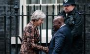 Theresa May in a handshake with President Akufo-Addo