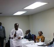 Picture by R.Harry Reynolds show the Finance Minister (in white with mic) addressing the function as the Diasporans (right)  listen to him