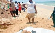 Larteley Mensah standing by the decomposed body of her daughter