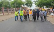 Osei Assibey Antwi and Ing Nana Poku Agyeman inspecting road works in the Manhyia South Constituency