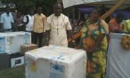 Hon. John Kofi Donyina presents a deep freezer to one of the beneficiaries