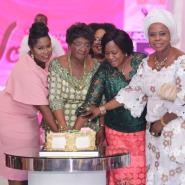 The award winners cutting a cake at the event
