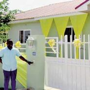 Obeng Amoako poses in front of his house