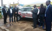 Officials at the event unveiling the vehicle at stake