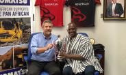 Mr Herbert Mensah, President and Board Chairman of the Union, shares the 2018 Rugby Africa Bronze Cup with Mr Tim Callaghan, General Manager of the Panafrican Equipment Group. Panafrican built and donated two scrum machines to Ghana Rugby