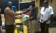 Tarkwa-Nsuaem MCE (middle) Presenting the equipment's to managers of the clinic