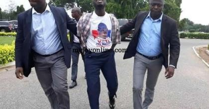 Kojo Mensah (M), being taken out of Parliament