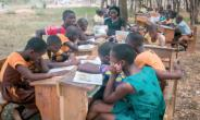 Students learning to read during one of reading clinics organized by OYE Foundation