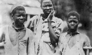 1910: Three Abyssinian slaves in iron collars and chains.