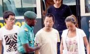 Aisha En Huang with her accomplices arriving at the court
