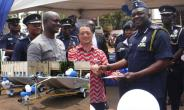 The Japanese Ambassador handing over keys to the alligator boats to the IGP